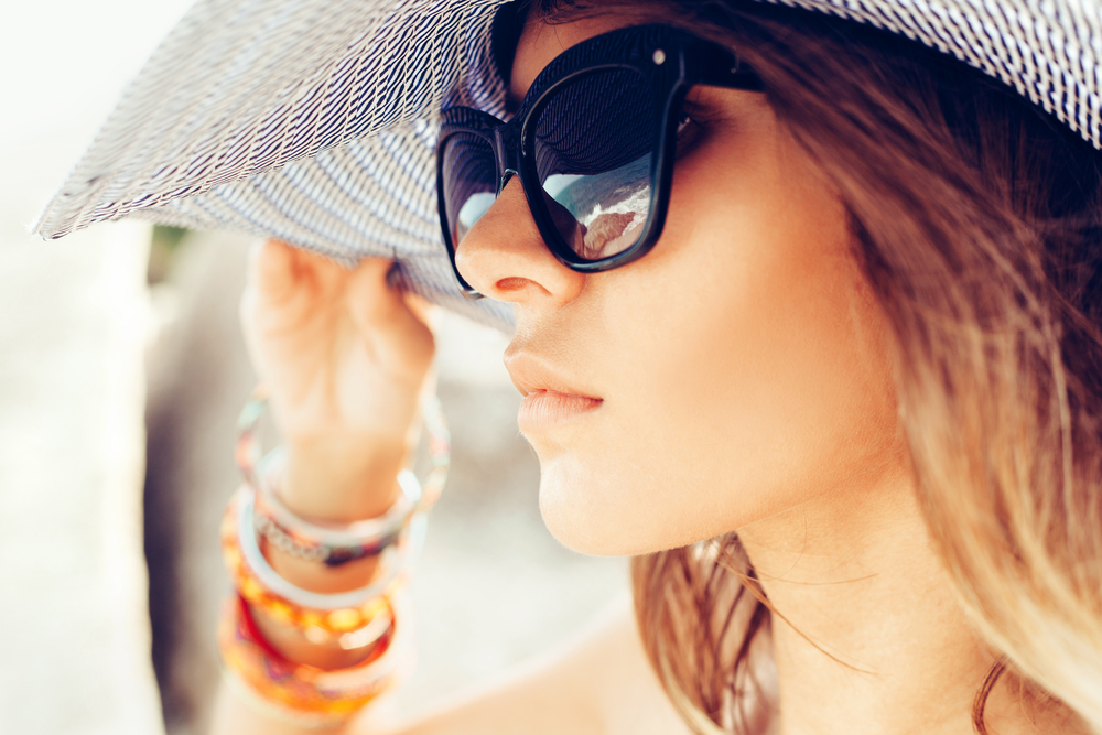 Close-up of face of young summer sexy woman wearing hat and sunglasses. Outdoors lifestyle portrait - Image( Kaponia Aliaksei)s