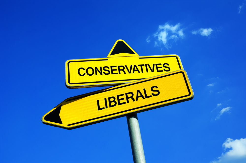 Conservatives vs Liberals - Traffic sign with two options - political preference of elector during elections( M-SUR)s