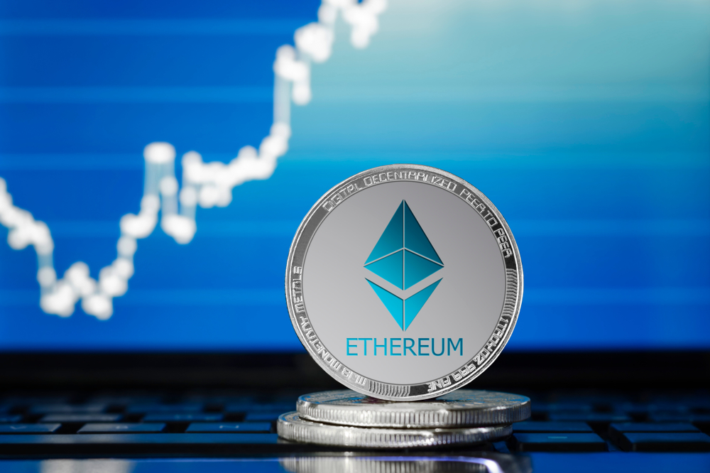 ETHEREUM (ETH) cryptocurrency; silver ethereum coin on the background of the chart - Image(AlekseyIvanov)s