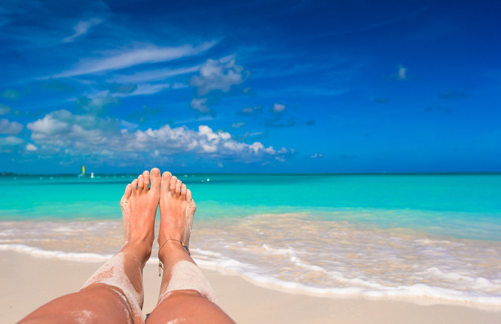 Female feet on white sandy beach - Image(TravnikovStudio)s