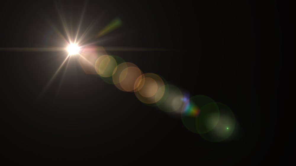 Lens Flare light over Black Background. Easy to add overlay or screen filter over photos - Illustration(senee sriyota)s