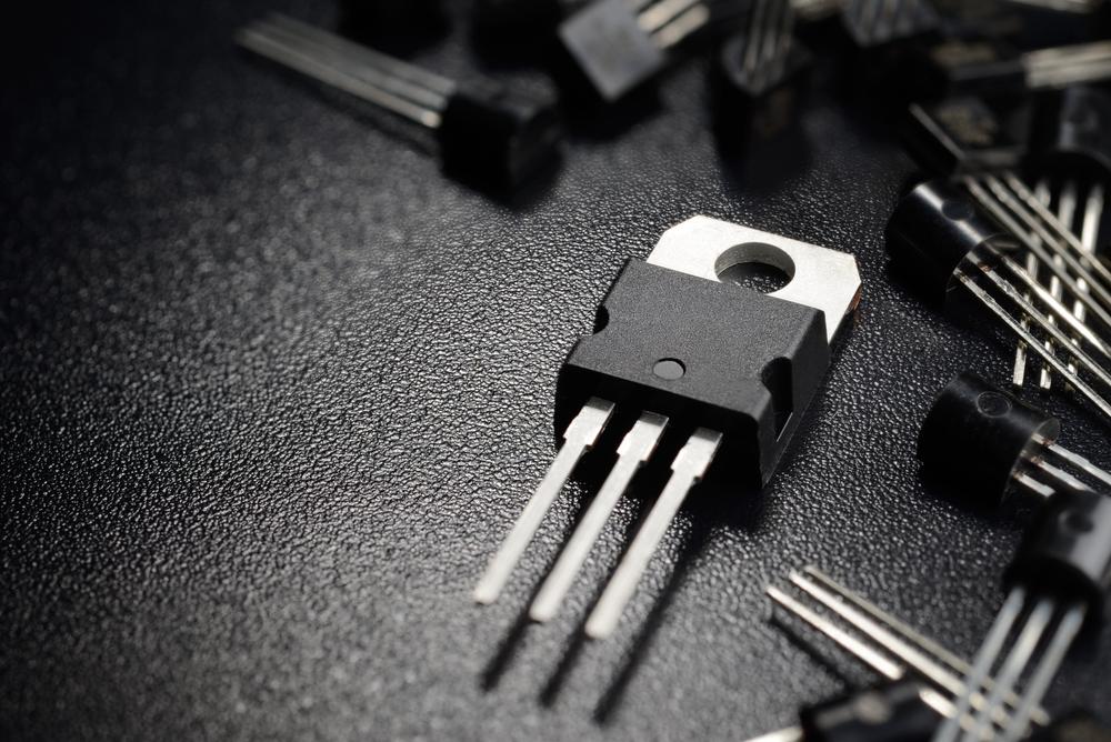 Macro shot of power transistors on the black surface - Image(Andrei Kuzmik)S
