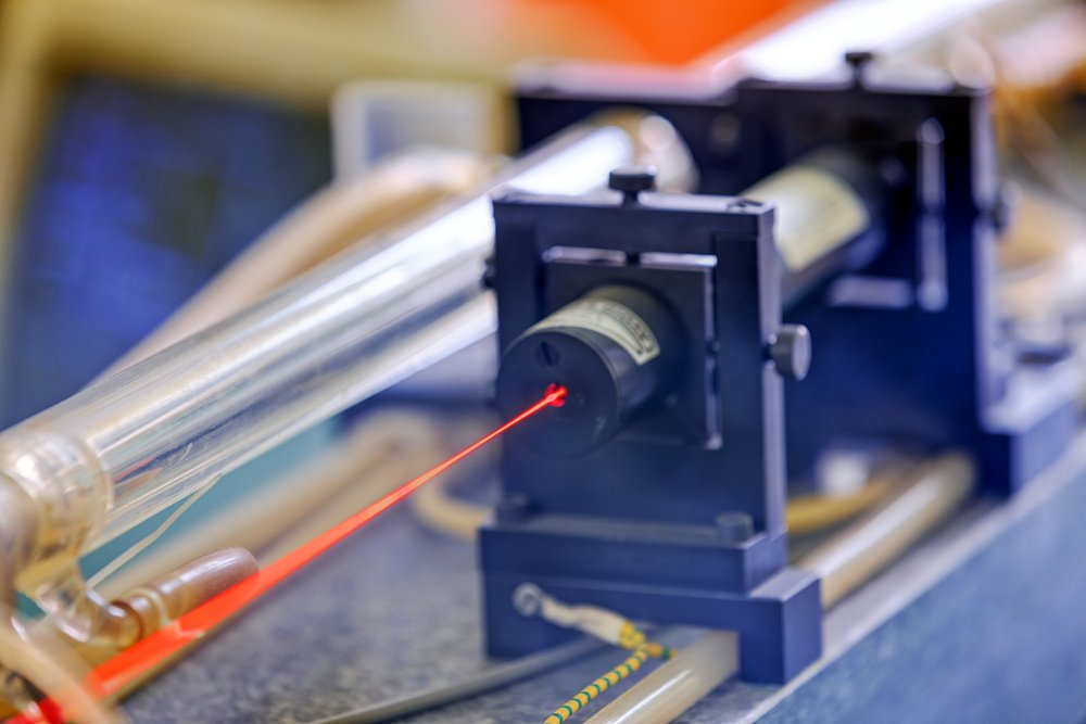 Red laser on optical table in physics laboratory - Image( Vladimir Nenezic)s