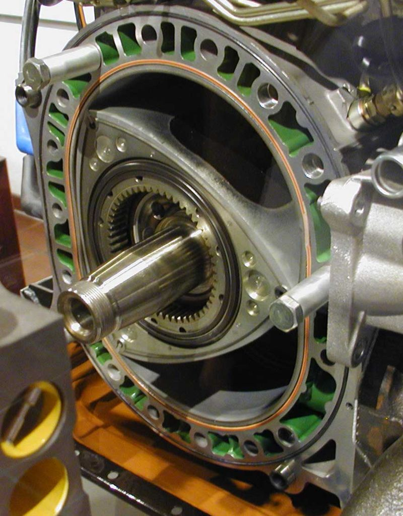 A Wankel engine with its rotor and geared output shaft clearly shown.
