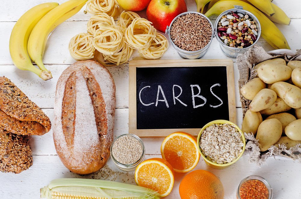 Best Sources of Carbs on a white wooden background. Top view - Image(bitt24)s