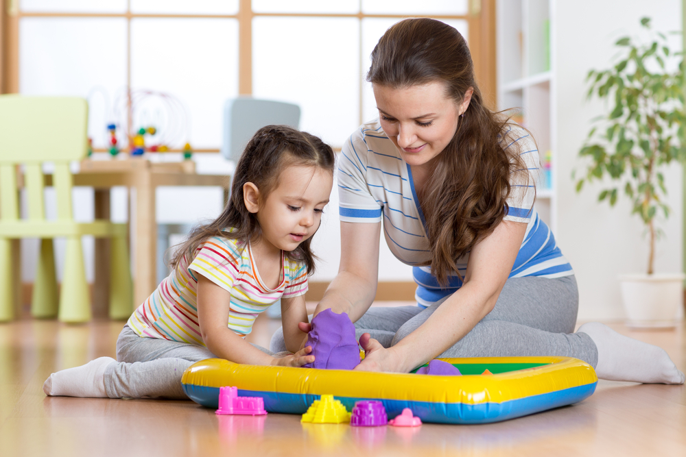 Child girl and mother playing with building toy sand at home - Image( Oksana Kuzmina)S
