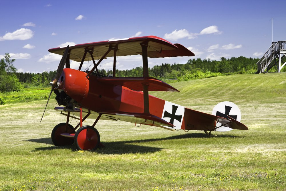 Classic Red Barron Fokker Dr.1 triplane on grass runway. - Image(KWJPHOTOART)s
