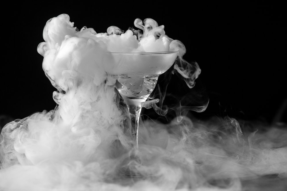Closeup glass with white fog at dark background. Chemical reaction of dry ice with water. - Image( Andrei Mayatnik)s