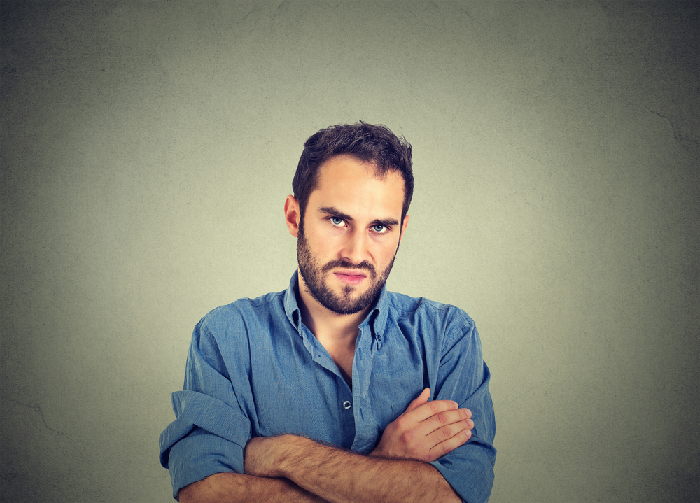 Closeup portrait of angry young man, about to have nervous breakdown, isolated on gray wall background(pathdoc)s