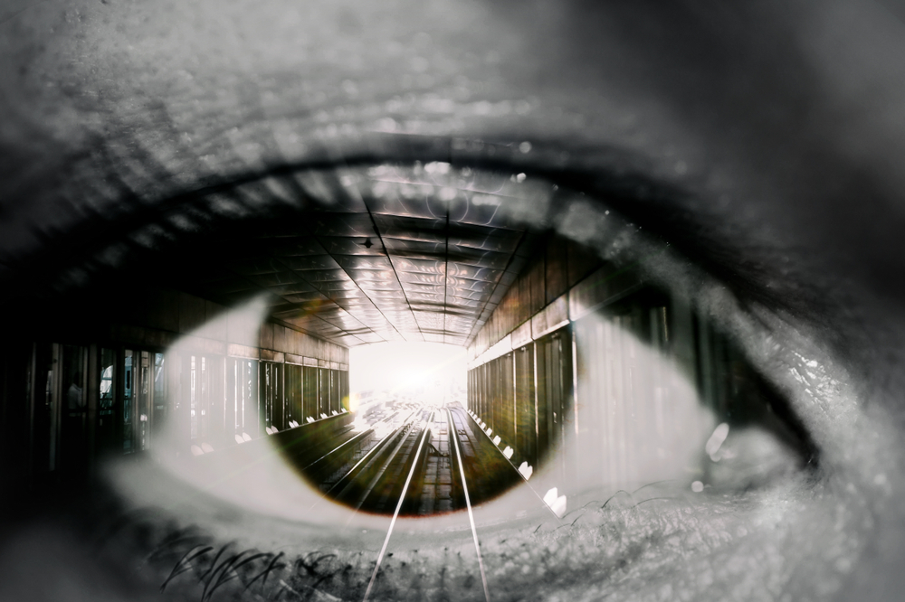 Double exposure of the female eye and tunnel with train car in subway - Image(FTiare)s