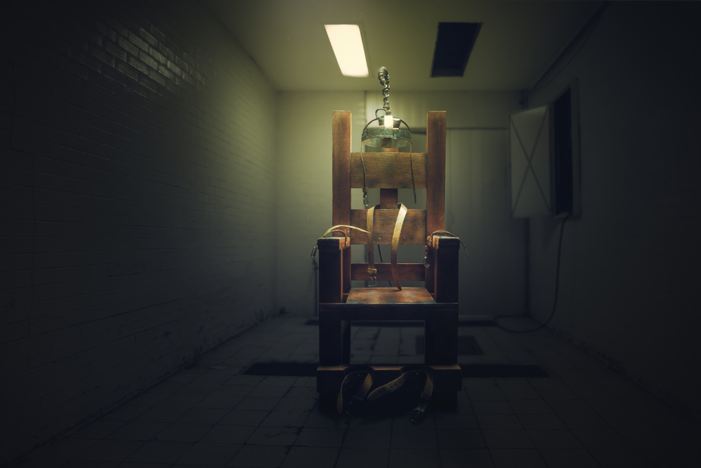 High contrast image of an electric chair on a dark room - Image( Fer Gregory)s