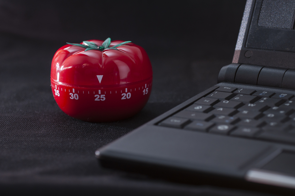 Mechanical Tomato shaped kitchen timer for cooking, studying and working. - Image(AlessandroZocc)s
