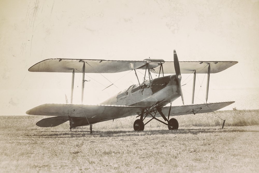 Old airplane at the airfield. Air travel with biplane - concept of retro aviation. Retro image of old aircraft.( Repina Valeriya)s