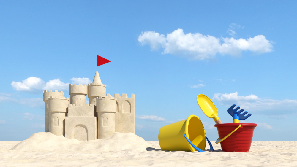 Summer vacation on the beach with sand castle and toys (3d rendering) - Illustration)( Robert Kneschke)s