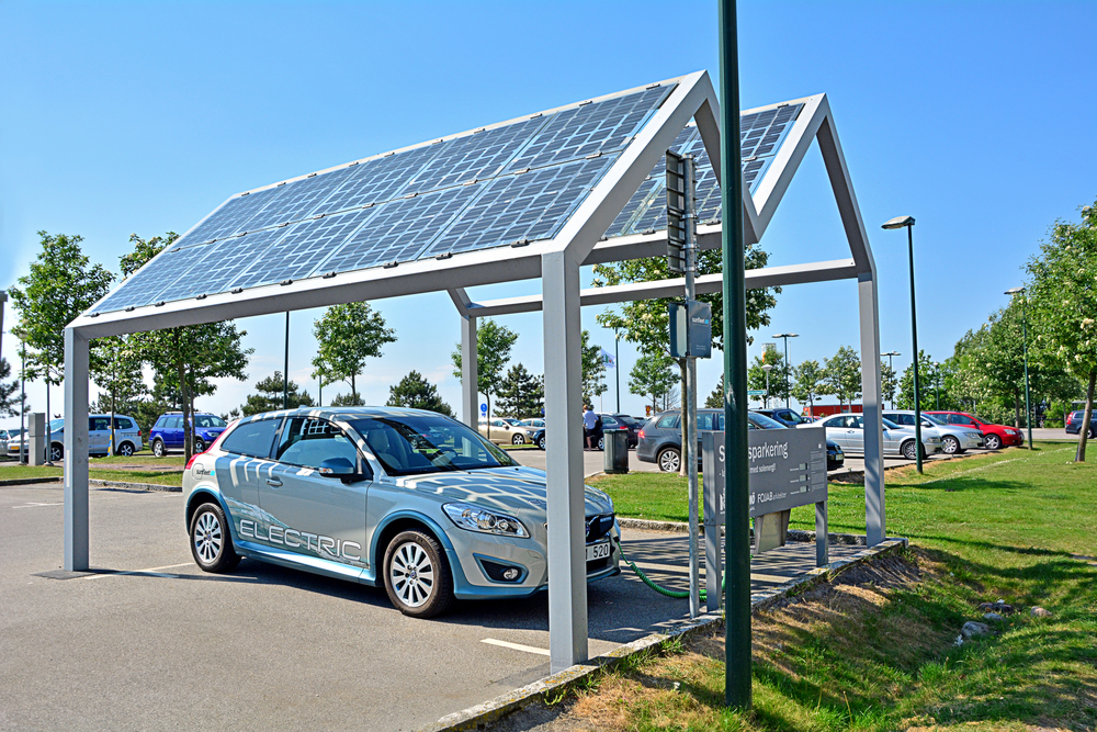 Electric car, part of the car-sharing system, standing at solar powered charge station (photovoltaics)( Martyn Jandula)s