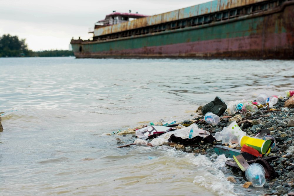Garbage in the sea with abandoned ship wreck, Environmental problem concept(SVRSLYIMAGE)s