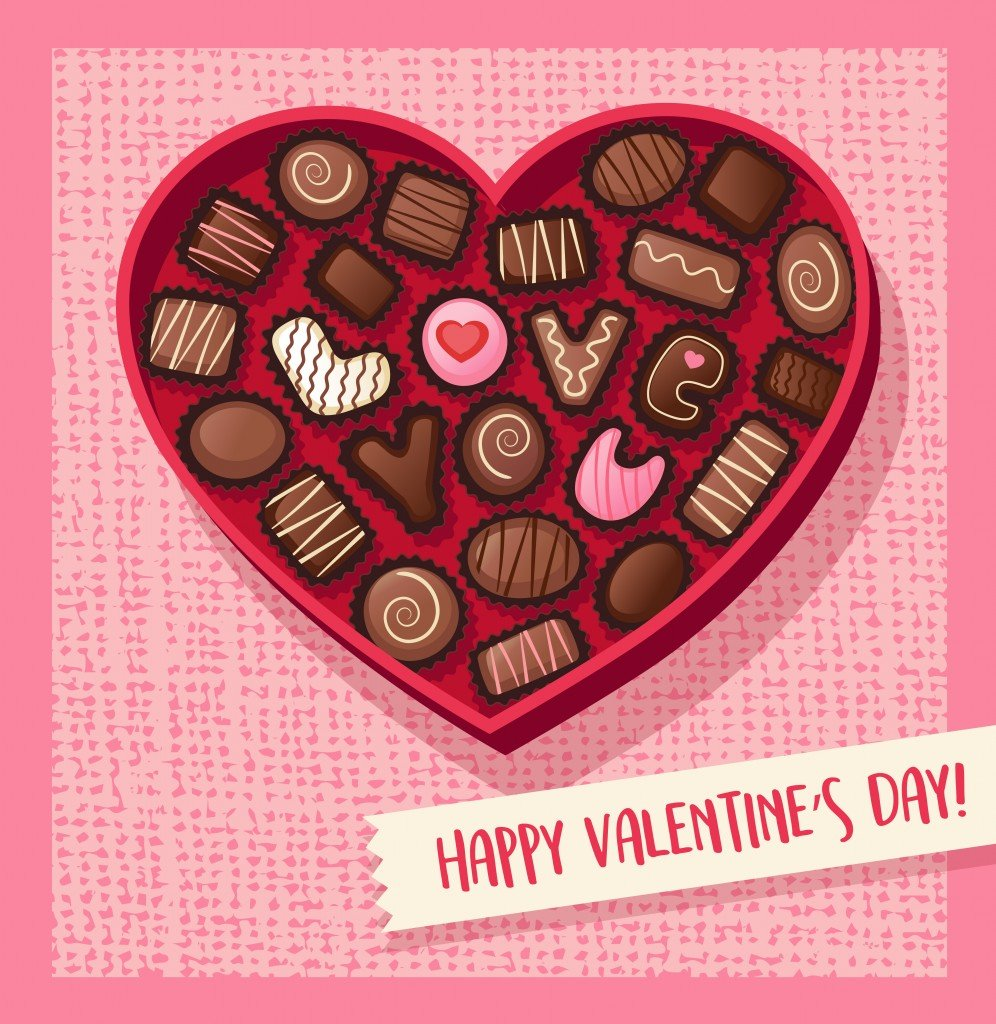 Heart shaped valentines day candy box with chocolate bonbons that spell Love You(TeddyandMia)s