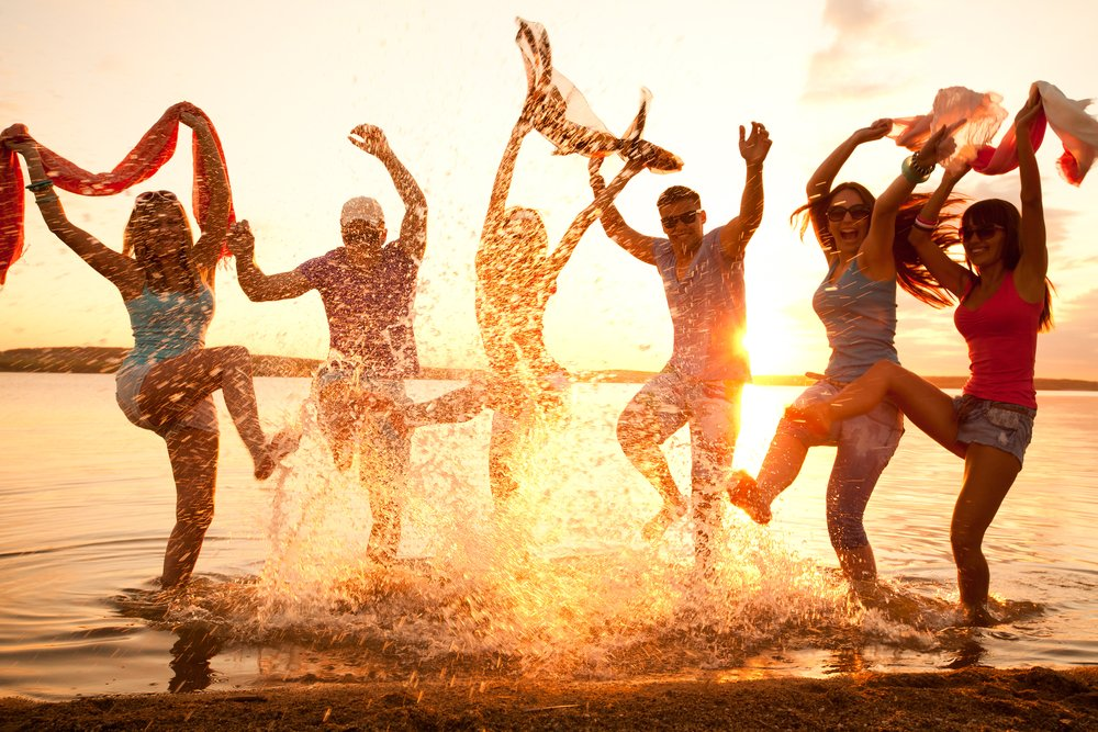 Large group of young people enjoying a beach party - Image(YanLev)S
