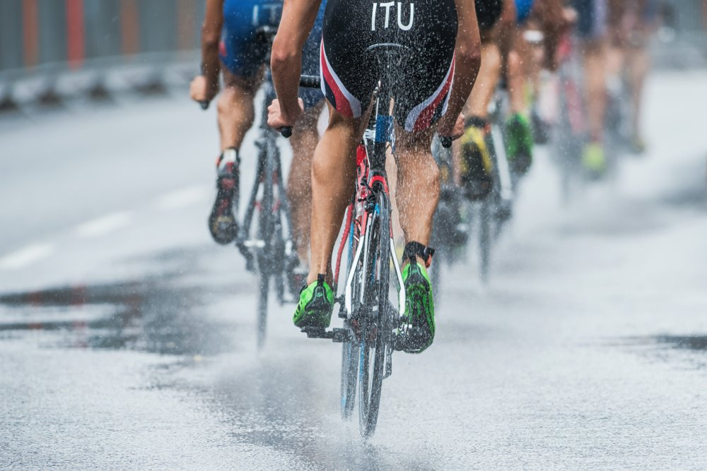 STOCKHOLM - AUG, 23 Triathletes cycling in the heavy rain with water spraying from the wheel( Stefan Holm)s