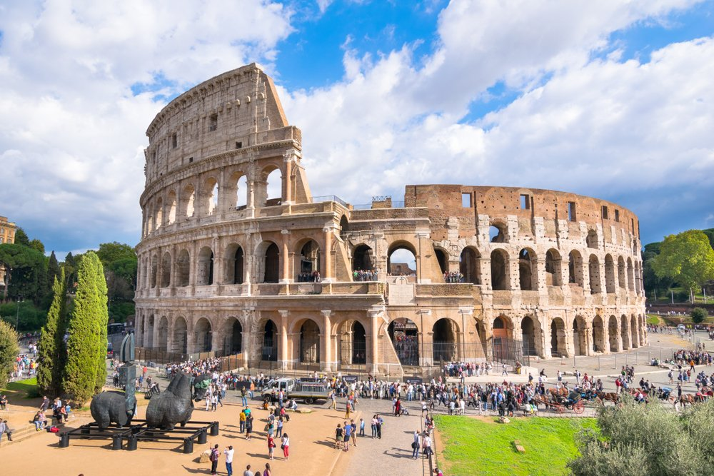 Tourists enjoy a sunny day to visit de fabulous Colosseum one of the 7 Wonders of the Modern World( Nido Huebl)S