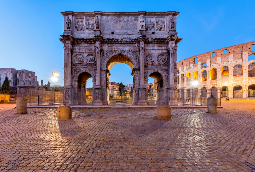 A dusk view of south side of Constantine's Arch, standing at between the Colosseum, right, and the Roman Forum, left( Sean Xu)S