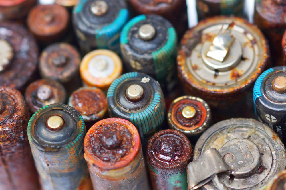 Old battery leak isolated Hazardous waste concept(wk1003mike)s