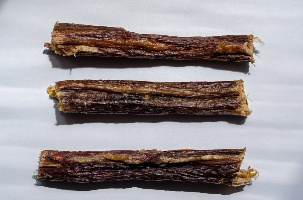 Three soft bully sticks. Dried beef esophagus for pets. Horizontal layout option( Dmitriev Mikhail)s