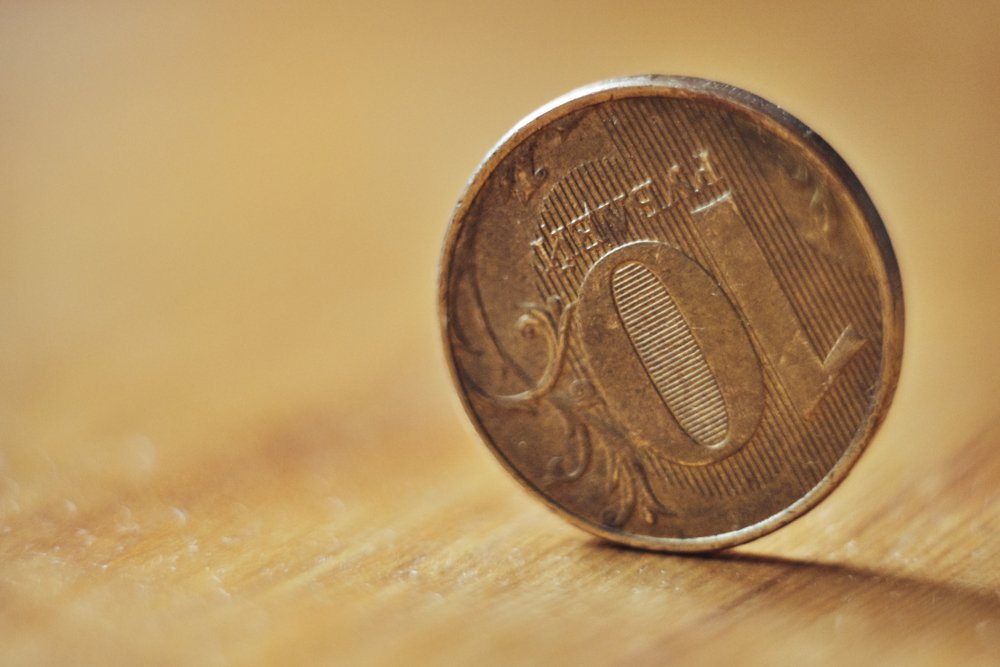 a ten-ruble coin stands on the edge( Alexander Sobol)s