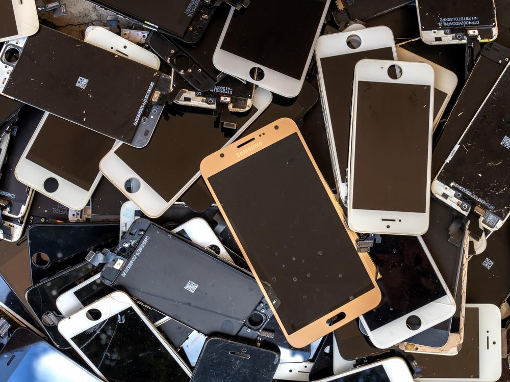 heap of broken smartphone screen (e-waste, electronic-waste)( Poravute Siriphiroon)s