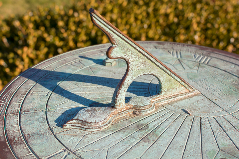 vintage sundial with green patina throws a long shadow, tracking the motion of the sun while telling the time of day( Jerry Regis)S