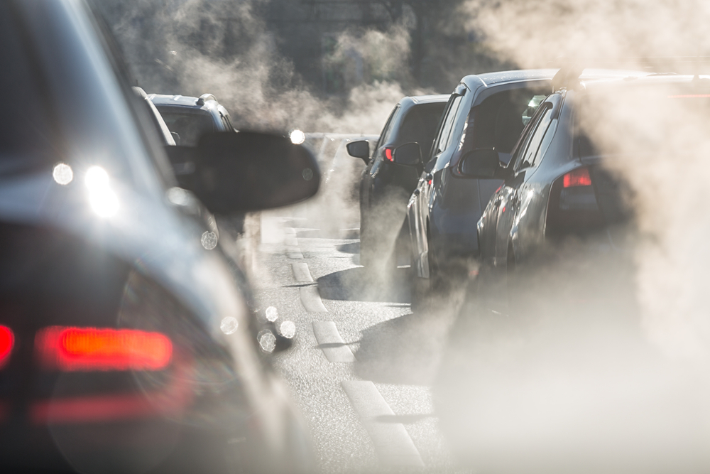 Blurred silhouettes of cars surrounded by steam from the exhaust pipes(LanaElcova)s