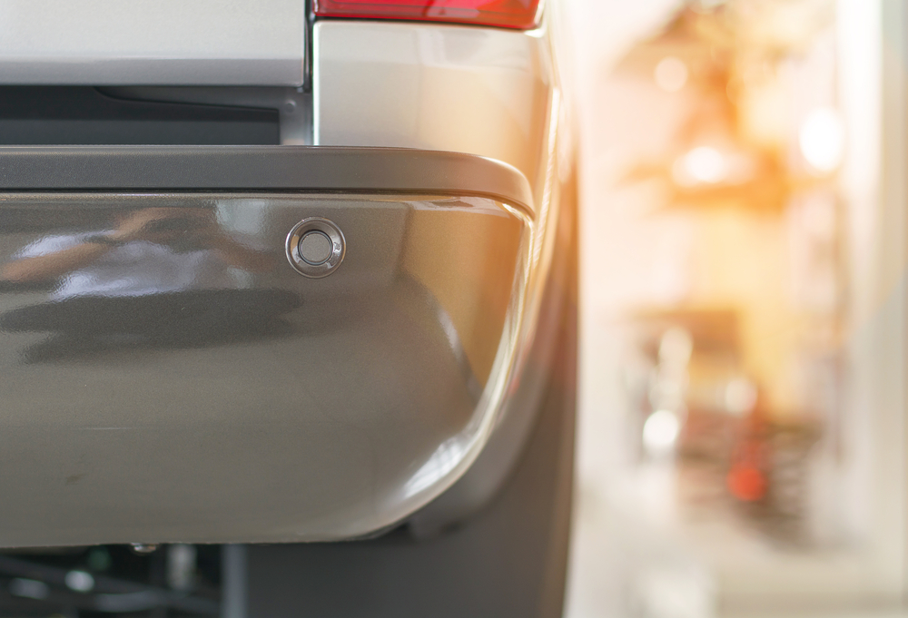 Selective focus parking sensor at rear car bumper on light blurred(CC7)S