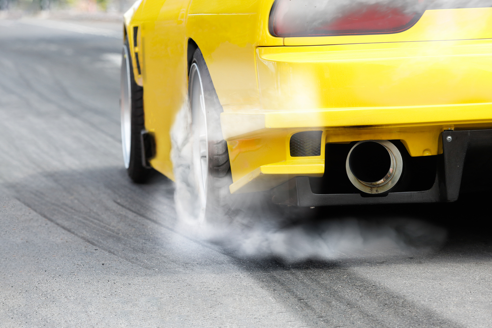 race car burns rubber off its tires in preparation for the race(Toa55)S