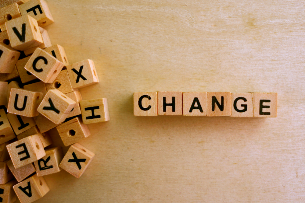 Change word cube on wood background(Sinart Creative)s