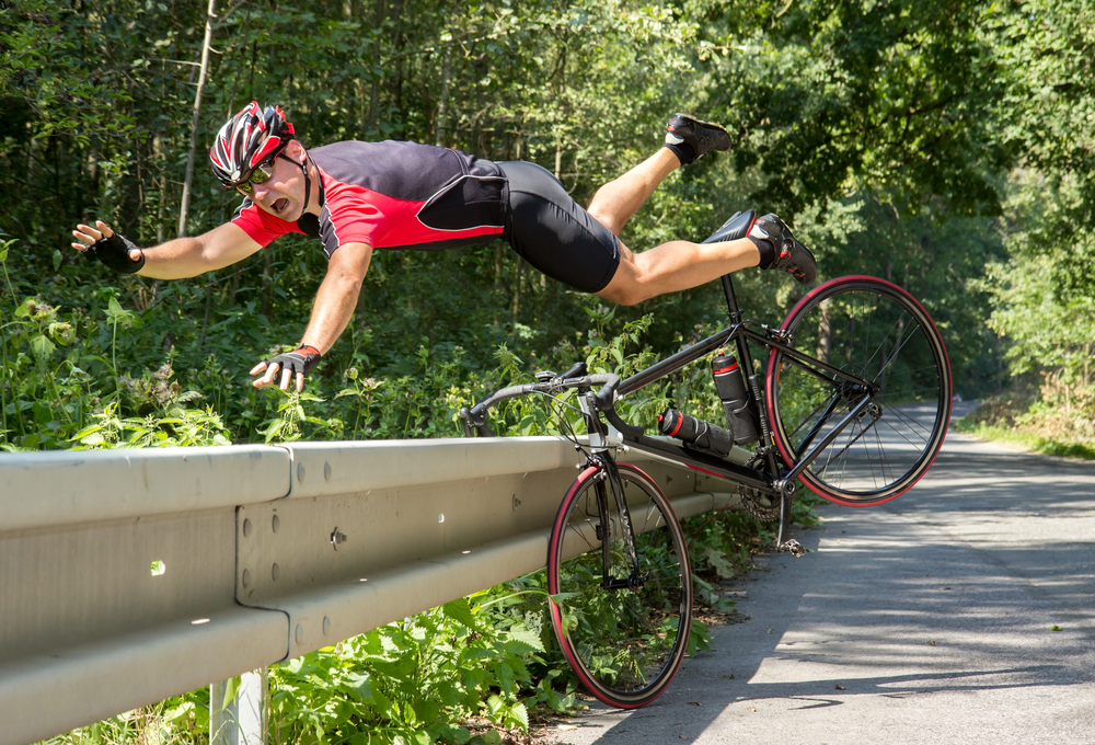Cyclist falls off the bike into bushes. Accident on the road(Milkovasa)s