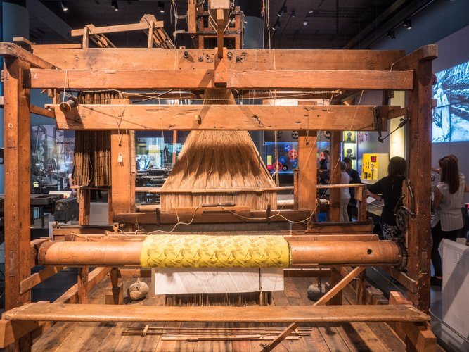 Jacquard loom is a power loom that simplifies the process of manufacturing textiles with such complex patterns as brocade(Mariusz S. Jurgielewicz)s