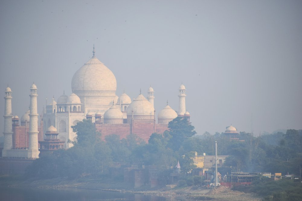 aj Mahal through Smog air pollution in India, impact of air pollution on Taj Mahal(DevilsAdvocate)s
