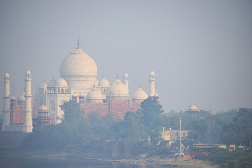 aj Mahal through Smog air pollution in India, impact of air pollution on Taj Mahal(DevilsAdvocate)s