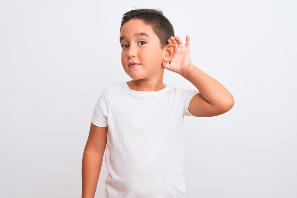 Beautiful kid boy wearing casual t-shirt standing over isolated white background(Krakenimages.com)s