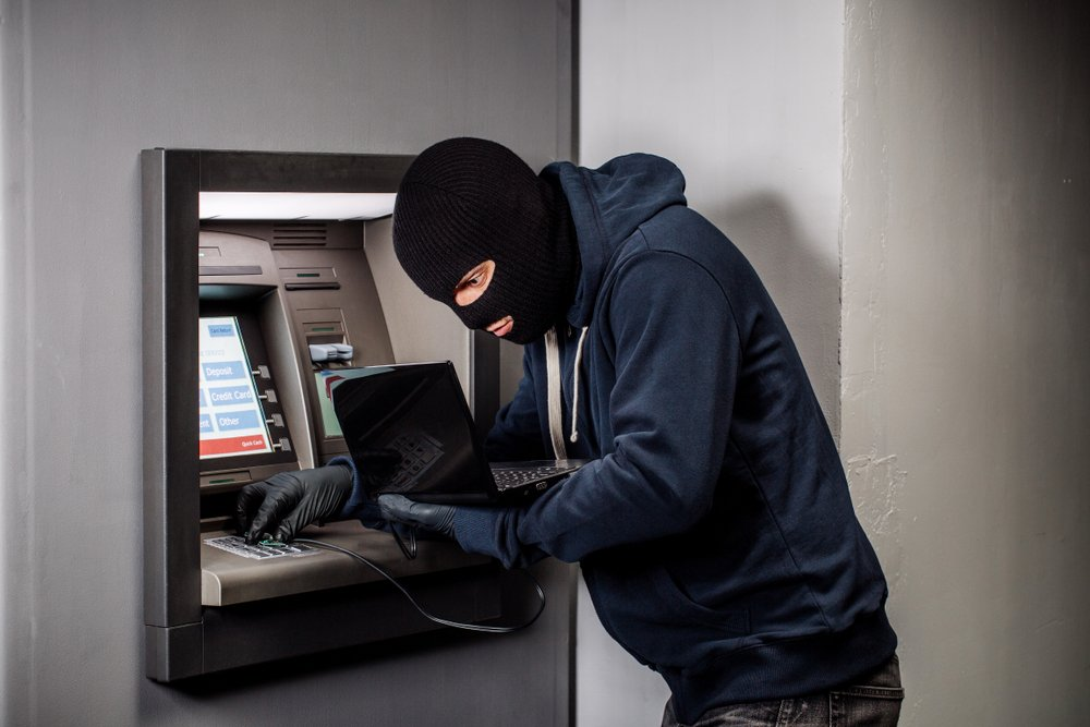Hacker stealing password and identity on atm machine(PRESSLAB)s