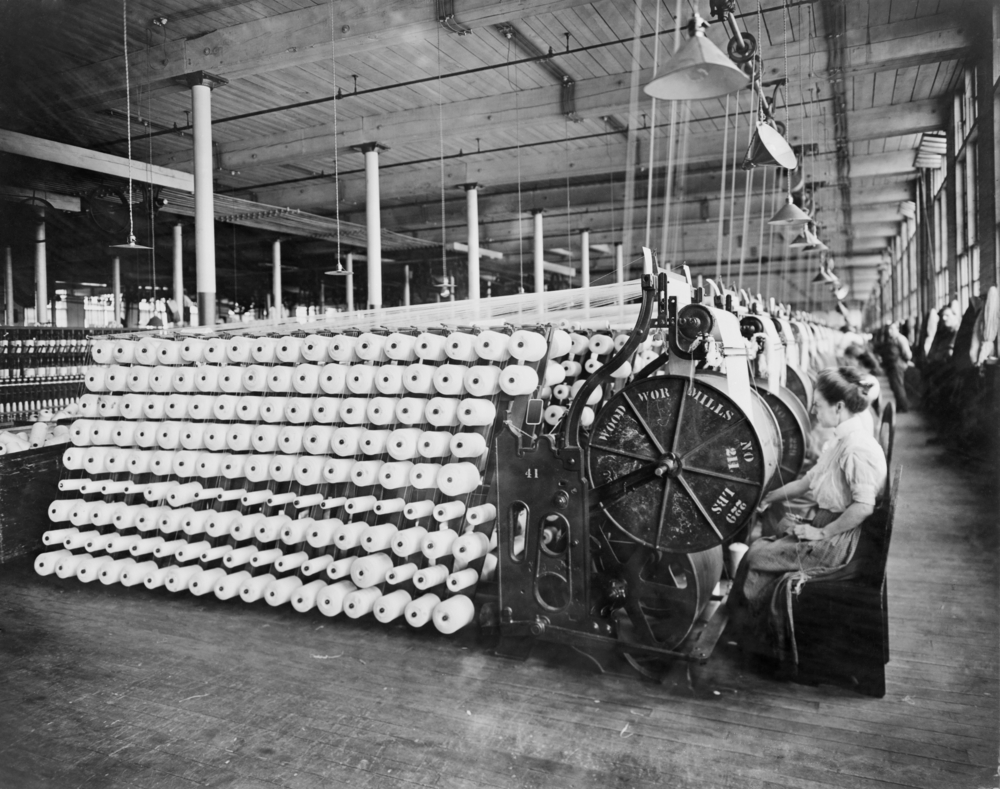 Women working at textile machines(Everett Historical)s