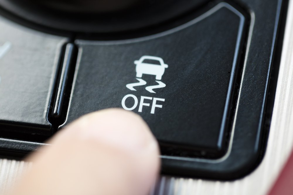 finger pressing Traction Control System button(Tom Wang)S
