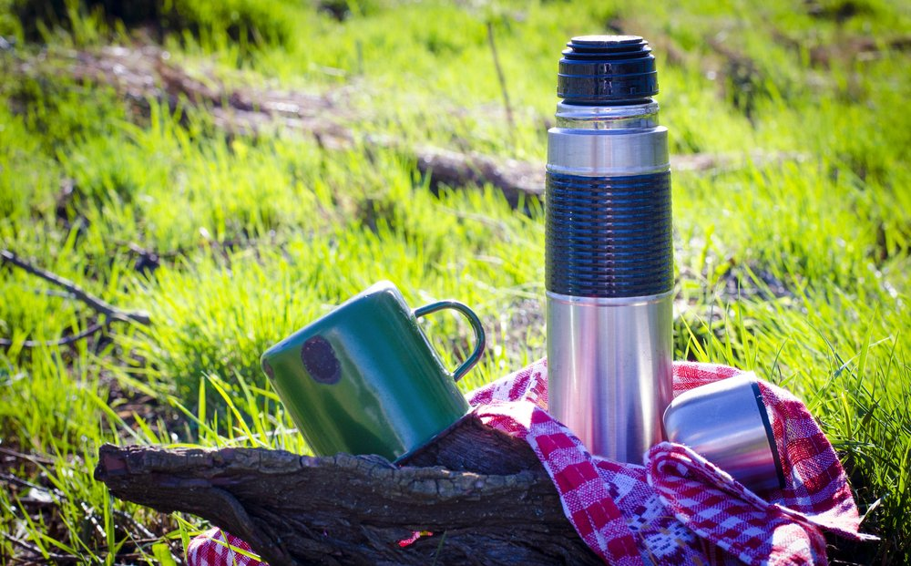 thermos and a cup used in nature(Katya123ua)s