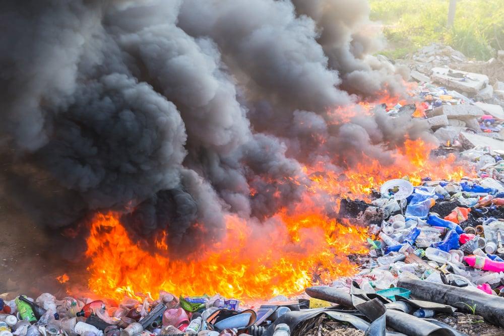 Burning garbage heap of smoke from a burning pile of garbage(SmerbyStudio)s