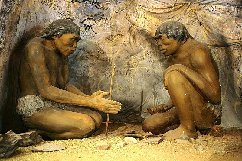 Homo Erectus early human trying to ignite fire