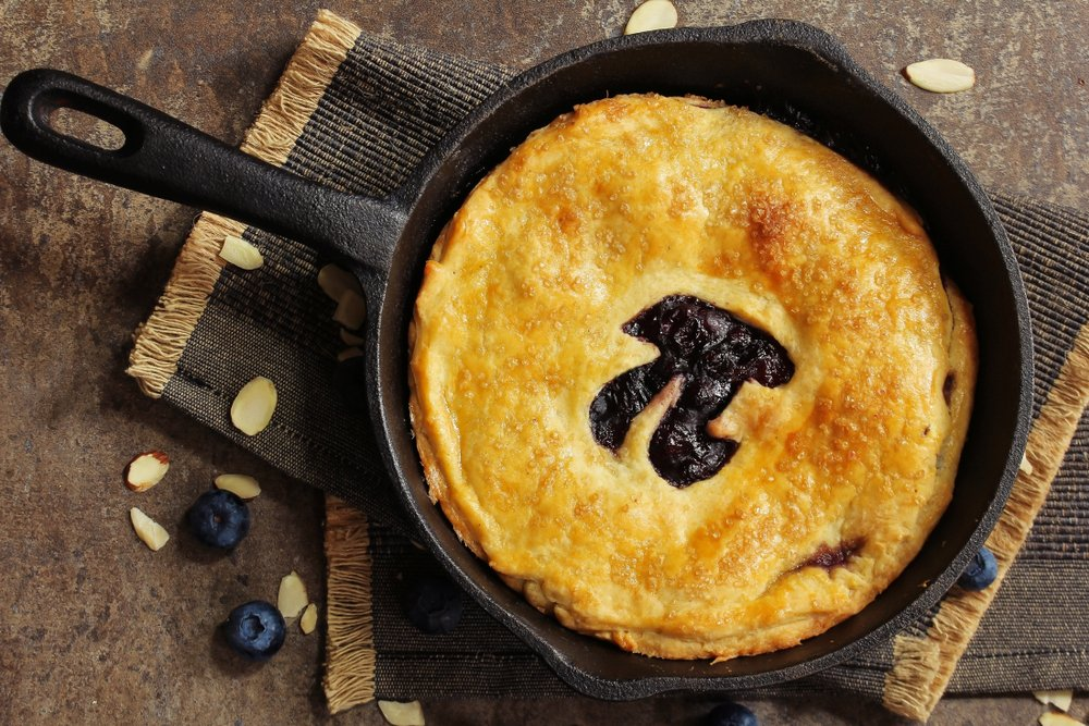 Pi Day special homemade blueberry pie baked in a skillet overhead view(vm2002)s