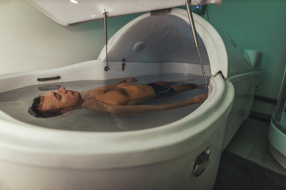 Relaxed man is floating in a sensory deprivation tank(MilanMarkovic78)S