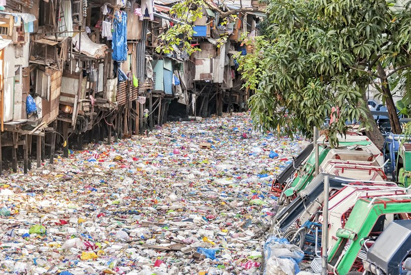 Shanties on stilts standing on garbage-filled river(Antonio V. Oquias)s