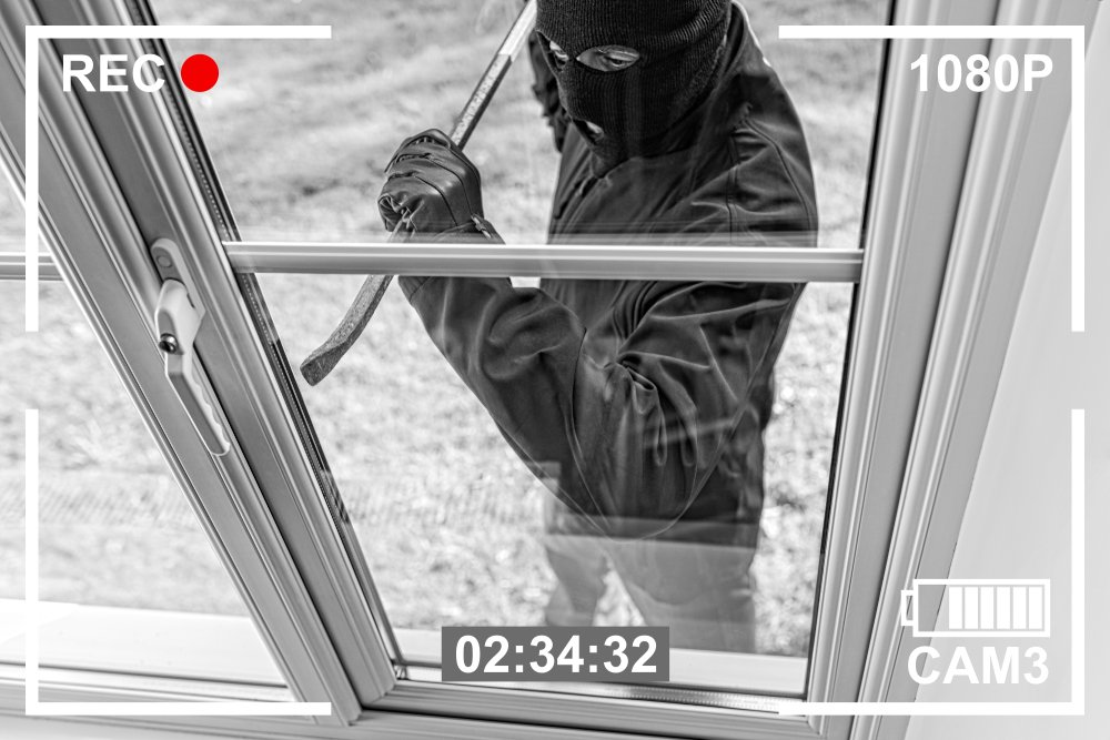 CCTV view of burglar breaking in to home through window with crowbar(Brian A Jackson)s