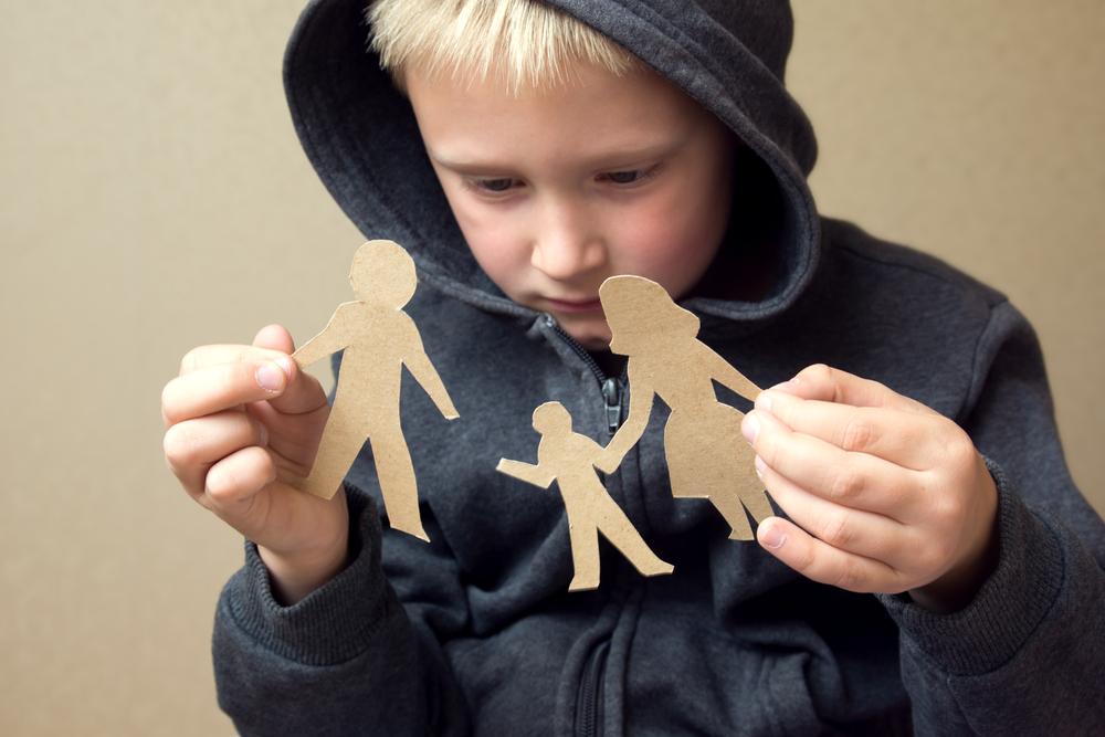 Confused child with broken paper family(Oksana Mizina)